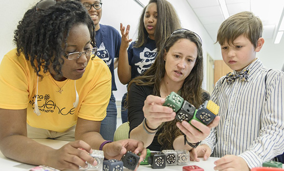 Photo of Science Everywhere participants during demonstration with blocks